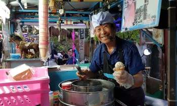 Man scooping ice cream