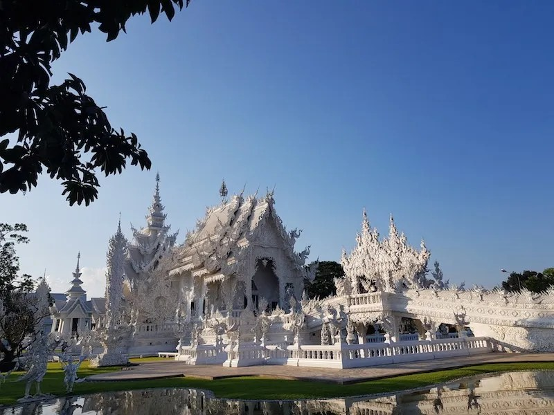 White temple with tree leaves