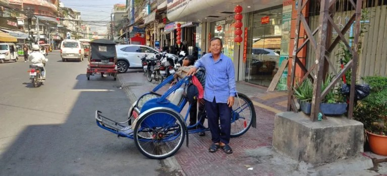 Man with bicycle taxi Cambodia on Three Wheels