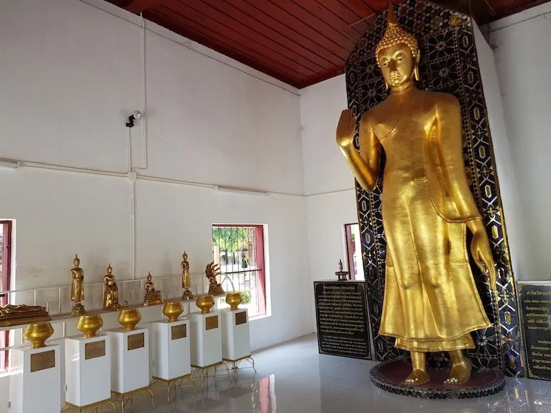 Standing Buddha image in temple Wat Phra Chao Mengrai
