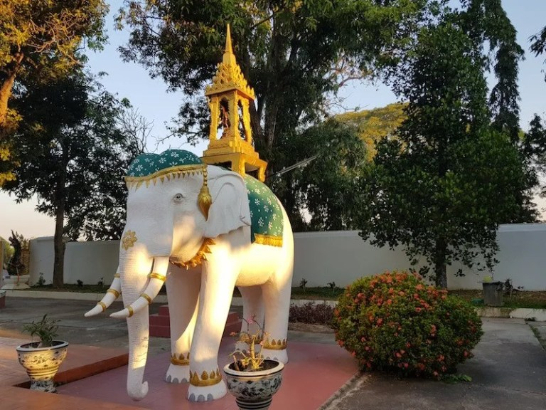 White elephant with small temple on its back Emerald Buddha