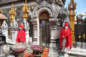 Two statues dressd in red