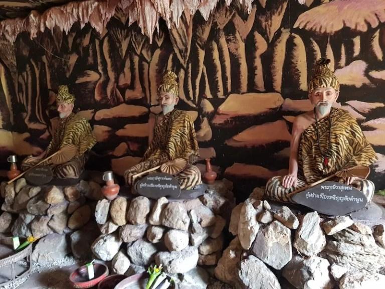 Three men in tiger dress Wat Chama Thewi Wat Ku Kut