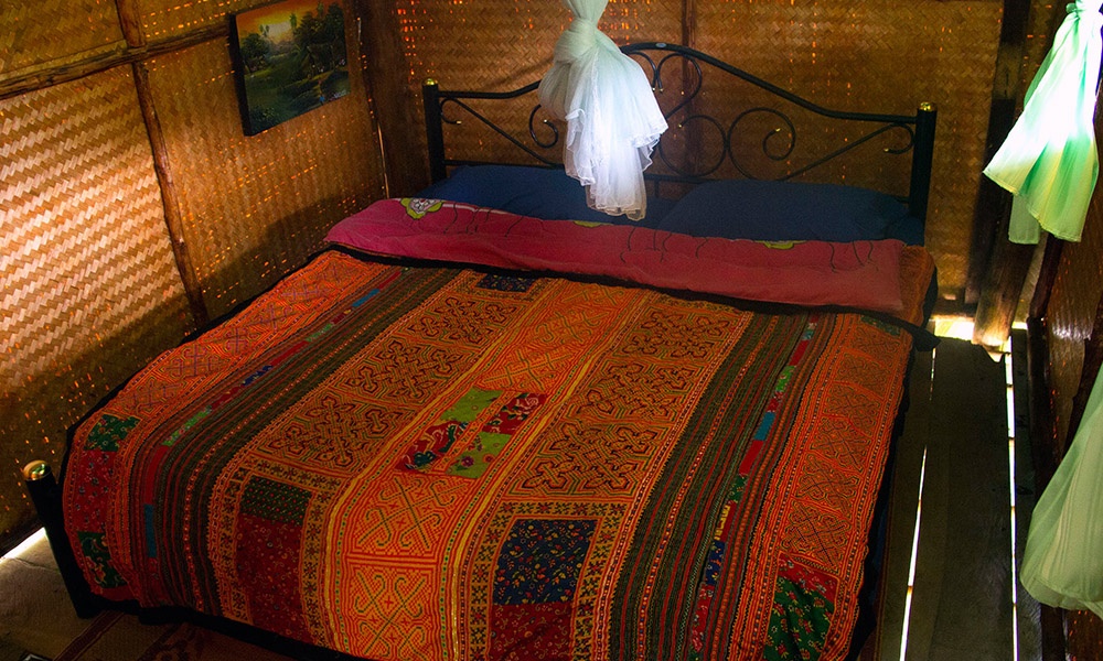Bed in private bungalow