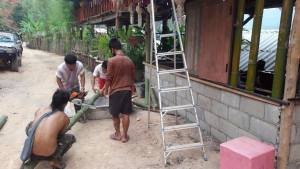 Cutting bamboo for a wall