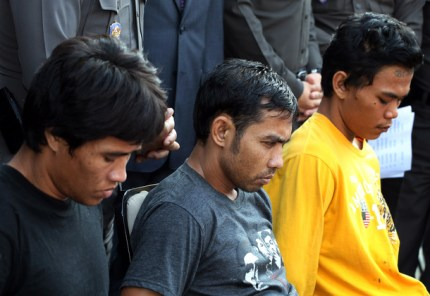 From left, Anuwat Wat-on, Wichien Jaija and Thongchai Jandee are shown at a police news conference on Wednesday after they were arrested on rape and robery charges. (AP Photo)