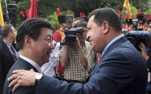 Venezuelan President Hugo Chavez welcoming China's president-to-be, Xi Jinping, at Miraflores Palace in Caracas in 2009
