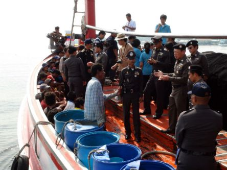 Anti-human trafficking division police search a fishing trawler in an estuary in Samut Sakhon for any crew who might have been trafficked to work on the ship, in this file photo from November 2012. It's alleged that 10 Cambodian human trafficking victims to be repatriated from Indonesia were sent to the country to work as fishermen via Thailand. Photo by Wassayos Ngamkham.