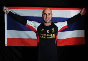 Liverpool goalkeeper Pepe Rena shows a Thai national flag to promote the club's pre-season visit to Thailand in July.
