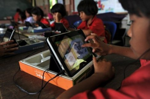 A student uses a tablet at Ban San Kong school in Mae Chan