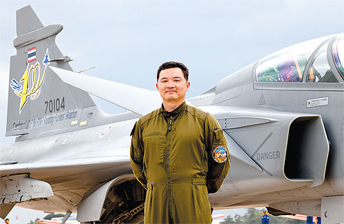 Gripen 39 C/D squadron commander Wg Cdr Jackkrit Thammavichai poses in front of a Gripen fighter.