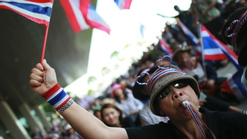An anti-government protester blows a whistle outside the Government complex in Bangkok, Thailand, Wednesday, Nov. 27, 2013. (AP Photo/Wason Wanichakorn)