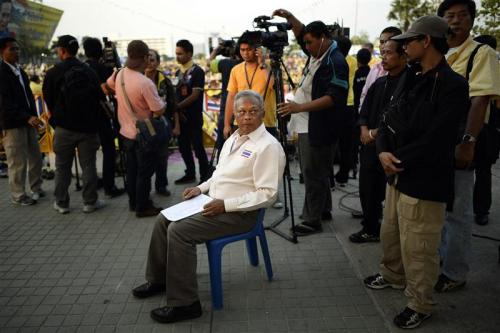 Protest leader Suthep Thaugsuban prepares to address anti-government protesters
