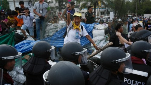 An anti-government protester shouts at riot police trying to retake a protest site in Bangkok, Thailand, Friday, Feb. 14, 2014. (AP / Wally Santana Read more: http://www.ctvnews.ca/world/thai-riot-police-reclaim-site-of-anti-government-protests-1.1685969#ixzz2tIy7RJLo