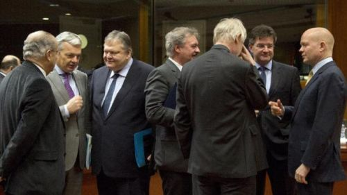 European Union foreign ministers speak with each other during a meeting of EU foreign ministers in Brussels