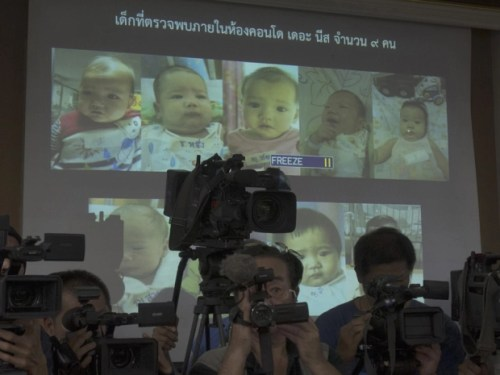 Thai police display pictures of surrogate babies born to a Japanese man who is at the center of a surrogacy scandal during a press conference at the police headquarters in Chonburi, Thailand.