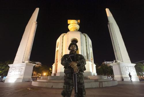 A Thai soldier stands guard at the Democracy Monument after a coup in Bangkok May 22, 2014