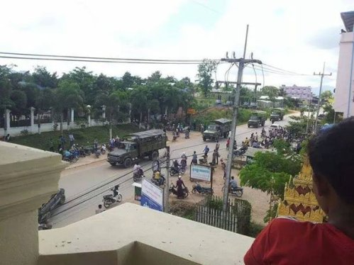 A photo taken by a Myawaddy resident shows Burma army forces moving through the town while some civilians attempt to flee the area on Saturday. (Photo: Nined Blood / Facebook)