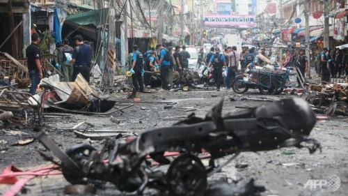 Members of a bomb squad inspect damaged vehicles after a bomb explosion outside a hotel at Betong district in Thailand's southern province of Yala. A car bomb exploded on July 25 outside a hotel in southern Thailand, killing three people and wounding more than 30 others. (AFP/Tuwaedaniya Meringing)