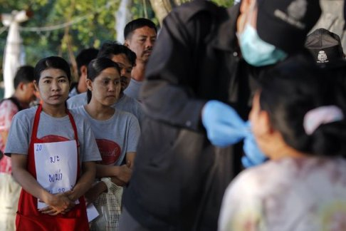 Migrant Workers for Myanmar line up for DNA testing on Koh Tao Island