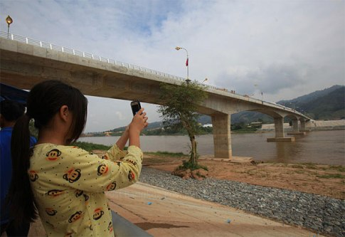 A visitor takes a photo at the fourth Thai-Lao Friendship bridge, which opened four months ago. It links Chiang Rai's Chiang Khong district