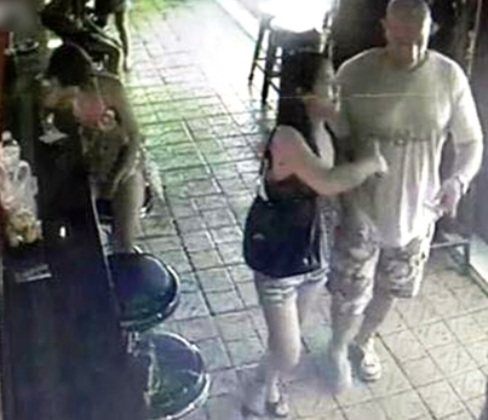 A capture from a CCTV camera inside Nana Entertainment Plaza shows Laxami Manochat leaving with the man who last saw her alive as they leave the Bangkok bar complex just before midnight Nov 1.