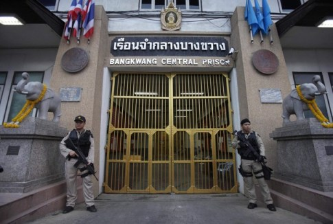 Guards stand holding weapons at Bangkwang Central Prison where suspected Russian arms smuggler Viktor Bout is being held in Nonthaburi Province