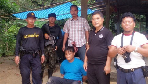 The officers found the confessed human smugglers hiding out at a local villager's house. Photo: Kritsada Mueanhawong