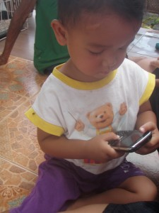 Mobile phones are popular among Thai children, who like to use it to play games