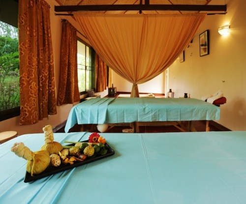 Gallery-Spa1-museflower_retreat_spa_thai_massage_room_herbal_display_on_bed