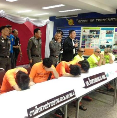 Pol Lt-General Sakda Chuenpakdee, commissioner of the Immigration Bureau parades foreign criminals in front of the press