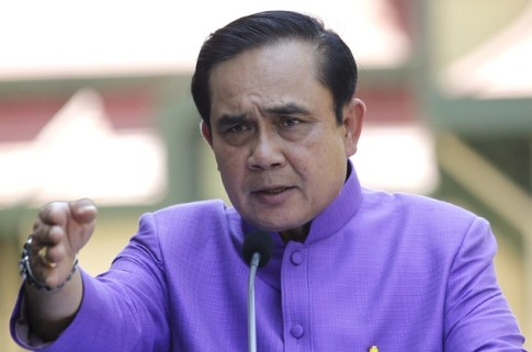 Thailand's Prime Minister Prayuth Chan-ocha answers questions from reporters during a press conference at the government house in Bangkok,