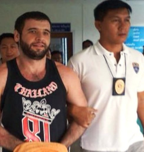 Mr Gasanguseynov is escorted to Phuket immigration office