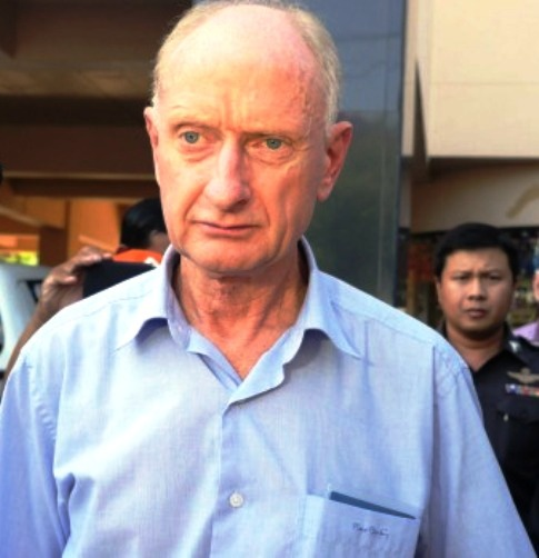 Peter Dundas Walbran with police after his arrest in Ubon Ratchathani, Thailand on December 9. Photo: Am Sandford