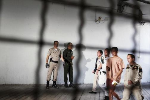 Patiwat Saraiyaem (2nd R), 23, arrives in leg shackles at Bangkok's Criminal Court in this February 23, 2015 file photo. REUTERS/Damir Sagolj/Files