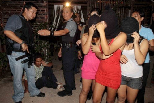 The raid at the Nataree Massage, a massage parlour on Ratchadaphisek Road detained 121 women, including under-age sex workers and foreigners.