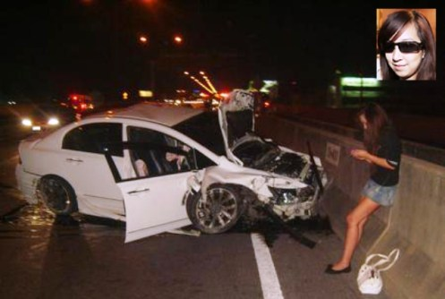 """Orachorn """"Praewa"""" Thephasadin na Ayudhya is seen using her mobile phone after the fatal accident."""