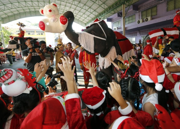 Elephant Santa's Help Distribute Gifts to School Children in Thailand