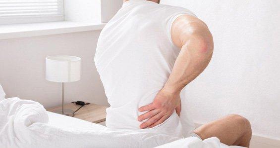 Come alzarsi dal letto senza avere dolori alla schiena