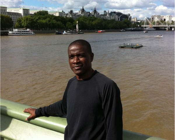 Adult Swimming Student Anthony Jackson in London overlooking the Thames River | Chicago Blue Dolphins