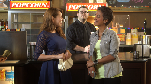 "Still from ""Zaynab Loves Movies,"" a promotional trailer shot for the Chicago International Film Festival. Left to right: Jessica Thigpen, Griffin Rhyne, Fawzia Mirza"
