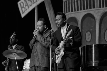 James Cotton and Muddy Waters performing in Jazz at the Opera House, Chicago, Illinois, 1963.