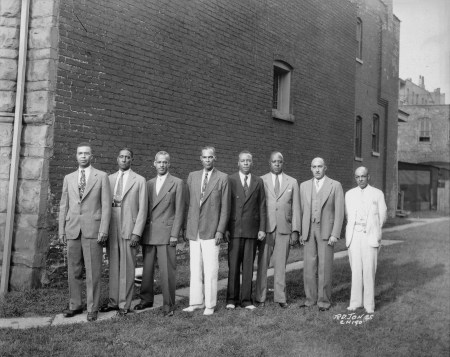 Photograph of eight officers of the Brotherhood of Sleeping Car Porters standing in a row