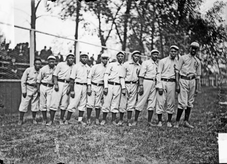 Negro National League's Chicago American Giants baseball team players standing on the field