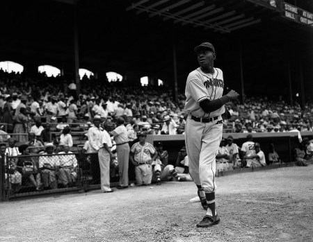 Satchel Paige warms up before the East-West Negro American League All-Star Game at Comiskey Park, Chicago, July 31, 1955