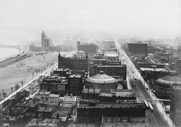 Aerial view of Chicago looking south down Michigan avenue two circular cyclorama buildings can be seen in foreground