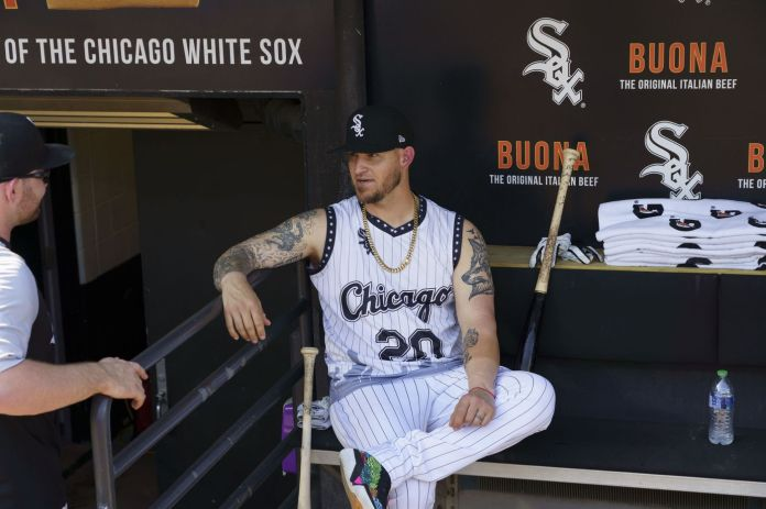 Chicago White Sox catcher Yasmani Grandal sits in the dugout before playing the Toronto Blue Jays at Guaranteed Rate Field on June 8, 2021.