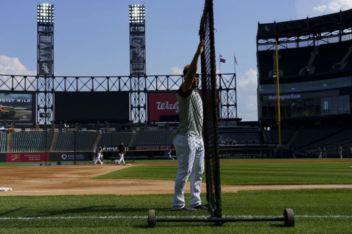 Chicago White Sox third baseman Yoan Moncada moves a net while warming up before playing the Toronto Blue Jays at Guaranteed Rate Field on June 8, 2021.