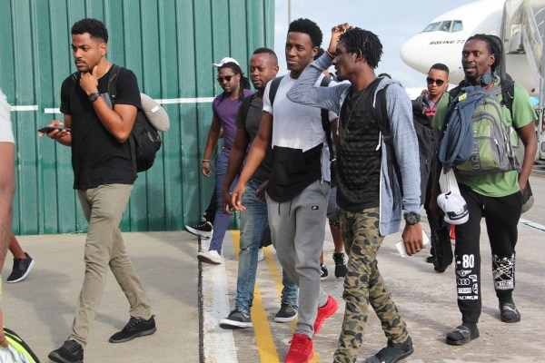 Romain Virgo and The Unit Band exit the aircraft and head to the VIP Lounge to meet with the press