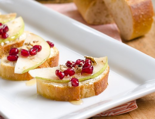 Pear, Pomegranate and Goat Cheese Crostini topped with Walnuts and Honey. | www.chicandsugar.com